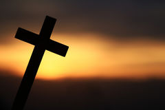 Silhouette of a Wooden Cross. In a beautiful sunset Royalty Free Stock Photography