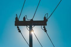 Silhouette wooden electric pole and power lines with sunset in the background at countryside. royalty free stock photo
