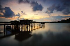 Silhouette of Wooden House and Walkbridge on Water Royalty Free Stock Photos