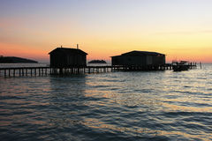 Silhouette of wooden jetty at sunrise, Koh Rong island, Cambodia Royalty Free Stock Image