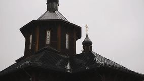 Silhouette of a wooden Orthodox Church with a Golden cross.  stock video
