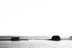 Silhouette of wooden pier in fishing village. Silhouette of wooden pier in small fishing village Garibaldi, Oregon, USA Royalty Free Stock Images