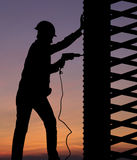 Silhouette worker. Silhouette of construction worker against sunset sky Royalty Free Stock Photography