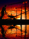 ---   Silhouette of the worker on a background of Stock Photography