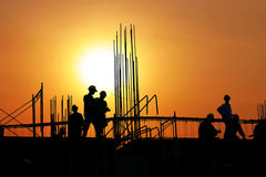 Silhouette workers. Silhouette of workers are working in the scaffold