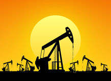 Silhouette of working oil pumps Royalty Free Stock Images