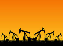 Silhouette of working oil pumps Stock Images