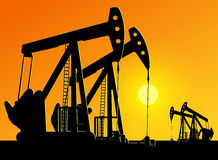 Silhouette of working oil pumps Royalty Free Stock Image