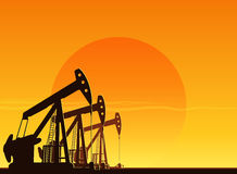 Silhouette of working oil pumps Royalty Free Stock Photo
