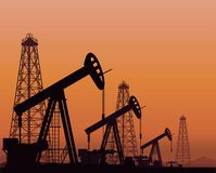Silhouette of working oil pumps on sunset background. Vector. Silhouette of oil pumps and rigs on sunset background Royalty Free Stock Photography