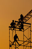 Silhouette of Workmen on assembling concert stage Royalty Free Stock Image