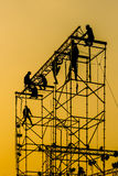 Silhouette of Workmen on assembling concert stage Royalty Free Stock Photo