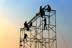 Silhouette of workmen at Twilight Stock Images