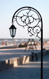Silhouette wrought park lantern against the beach and sea in sum Stock Photo