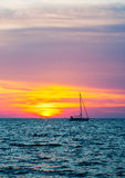 Silhouette of a yacht on the last rays of sunset Stock Photography