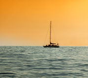 Silhouette of the yacht at sunset  background Stock Photography