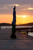 Silhouette of yoga position. During sunset Royalty Free Stock Photography