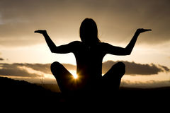 Silhouette yoga sitting Royalty Free Stock Photography