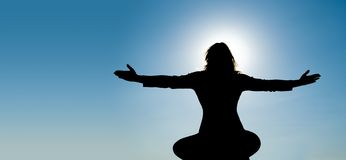 Silhouette of Yoga at summit Stock Photography