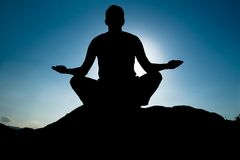 Silhouette of Yoga at summit Stock Photo