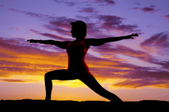 Silhouette yoga woma lunge arms out Stock Photo