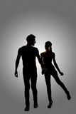 Silhouette of young Asian couple Royalty Free Stock Images