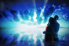 Silhouette of young asian couple on the sea Stock Photos