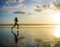 Silhouette of young Asian sport runner woman in running workout stock photos