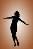Silhouette of young Asian woman pose Stock Photography