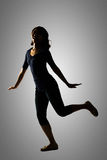 Silhouette of young Asian woman Stock Photo