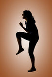 Silhouette of young Asian woman pose Stock Image