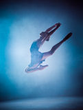 The silhouette of young ballet dancer jumping on a Stock Photo