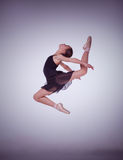 The silhouette of young ballet dancer jumping on a Royalty Free Stock Images
