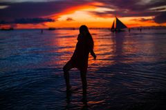 Silhouette of young beautiful woman at tropical Royalty Free Stock Photo