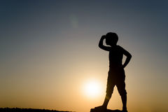 Silhouette of Young Boy Looking into the Distance Royalty Free Stock Image