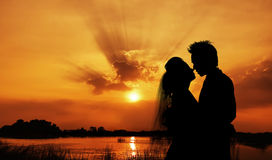 Silhouette of a young bride and groom on Sunset Royalty Free Stock Image