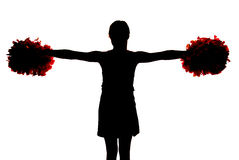 Silhouette of a young cheerleader holding her pompoms straight o Stock Photos