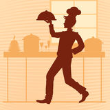 Silhouette of a young chef in the kitchen of the restaurant. vec Royalty Free Stock Photo