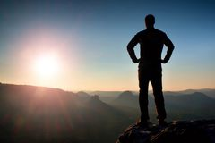 Silhouette of Young Confident and Powerful Man Standing with Hands on Hips, Morning Or Late Day Sun with Copy Space Stock Photos