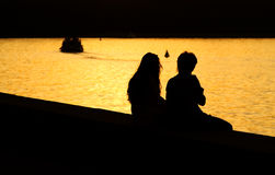 Silhouette of Young Couple. At Sunset Royalty Free Stock Photography