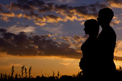 Silhouette of a young couple royalty free stock photos