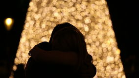 Silhouette of young couple on blurred light background stock video footage
