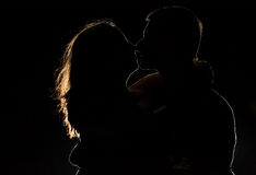 Silhouette of a young couple in the dark Stock Photos
