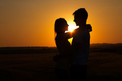 Silhouette of young couple in field. Stock Photography