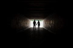 Silhouette of young couple holding hands. Silhouette of young happy couple holding hands Stock Image