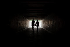 Silhouette of young couple holding hands. Silhouette of young happy couple holding hands Stock Photography