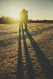 Silhouette of a young couple kissing in the sunset people Royalty Free Stock Photography