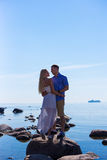 Silhouette of young couple in love over sea background Royalty Free Stock Photography