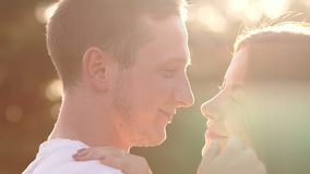 Close-up portrait of a kissing young couple at sunset. stock video