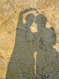 Silhouette of a young couple on an orange beach rock Royalty Free Stock Image